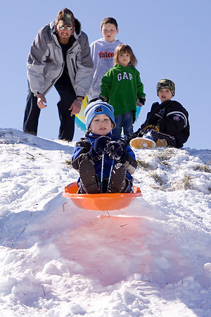 Sledding in the January snow. Andy Griffin Photography.
